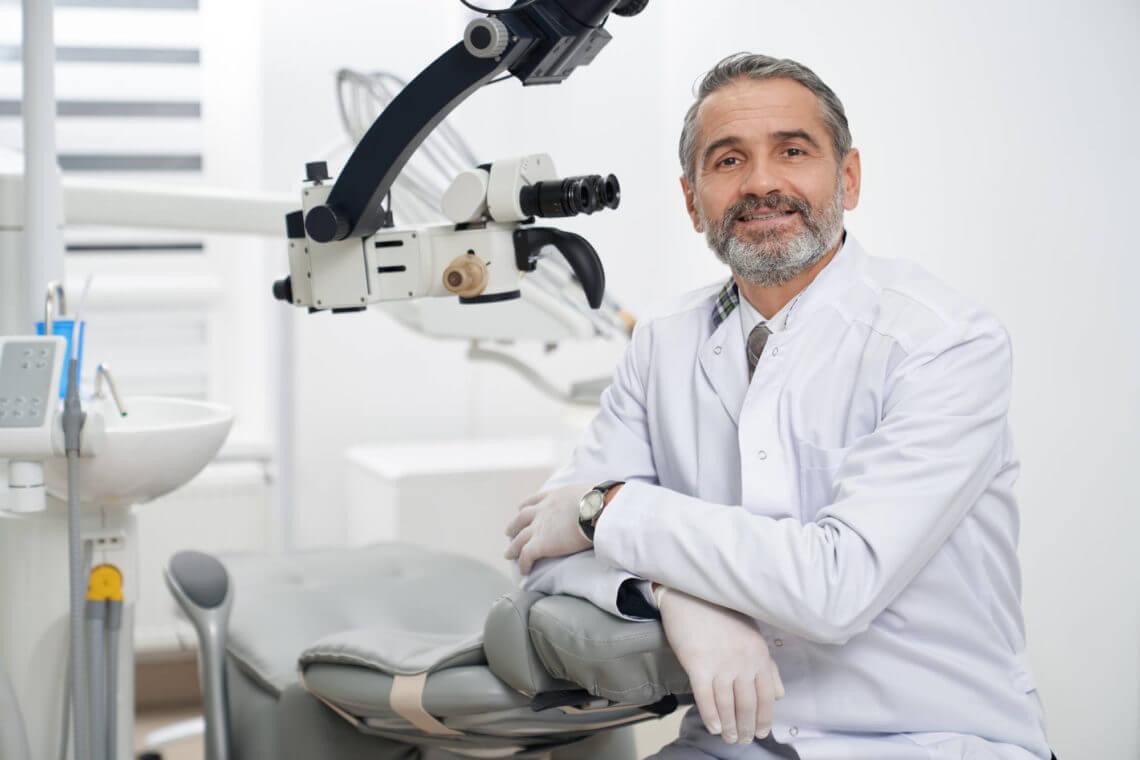 dentist-posing-on-workplace-in-modern-clinic-RHDBPL7.jpg